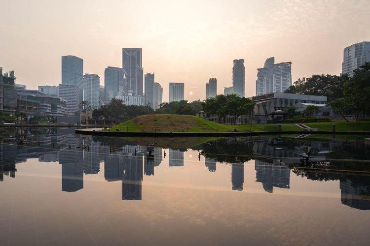 Hazy  Sunrise at Kuala Lumpur Suria KLCC Petronas Twin Towers Cityscapes Skyline Reflection