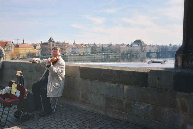 He plays in one of the many classical music concerts offered in Prague. Live Music Music Street Artist Tourist Attraction  Cityscape Lifestyles Melody Musician Real People Sitting Streetphotography Travel Destinations The Street Photographer - 2018 EyeEm Awards The Street Photographer - 2018 EyeEm Awards