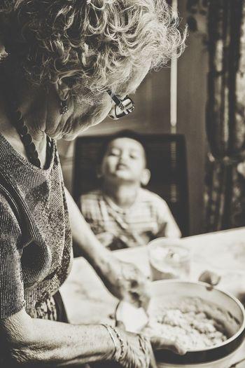 Grandmother preparing cake