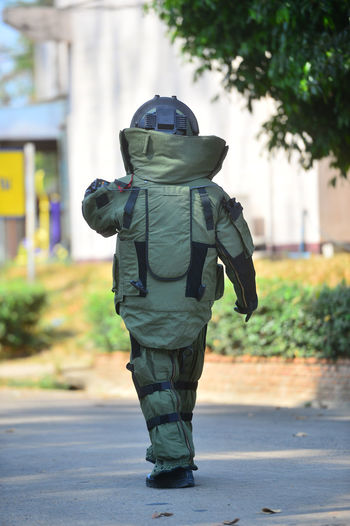 Full length of person wearing protective workwear