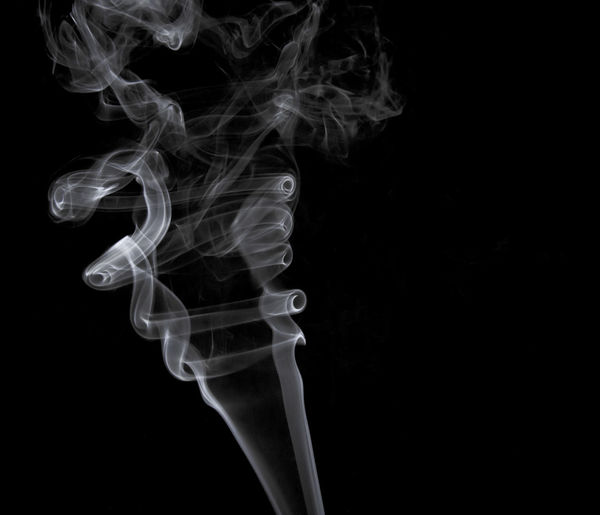 Abstract Black Background Burning Changing Form Close-up Copy Space Cut Out Design Emitting Illuminated Indoors  Luminosity Motion Moving Up No People Pattern Smoke Smoke - Physical Structure Studio Shot Swirl White Color