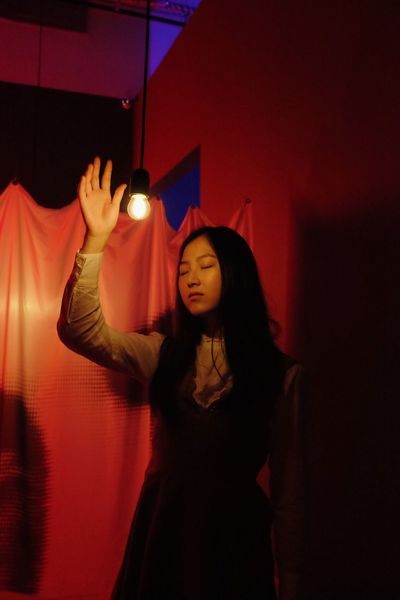 Red Color Standing Real People Indoors  One Person Front View Red Leisure Activity Long Hair Waist Up Three Quarter Length Lifestyles Illuminated Casual Clothing Young Adult Hairstyle Women Young Women Gesturing Hair Human Arm Red Light EyeEmNewHere The Week on EyeEm Pretty Girl