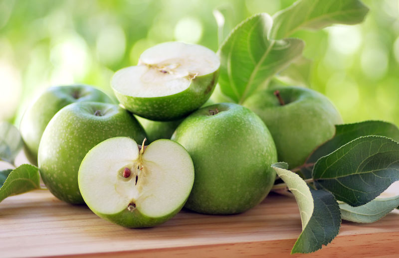 Close-up of green apples on table
