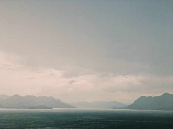 Lake view during storm, Stresa. Beauty In Nature Calming Day Fog Lake Landscape Mountain Nature No People Outdoors Rain Scenery Scenics Sky Storm Tranquil Scene Tranquility Water