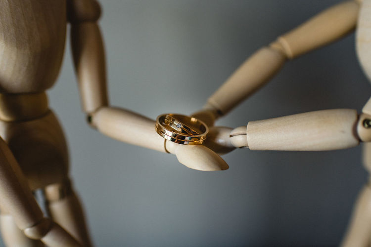 Hand Close-up Human Hand Indoors  Focus On Foreground Ring Celebration Gold Colored Human Body Part Metal Wedding Life Events People Jewelry Holding Figurine  Selective Focus Gold Event Positive Emotion Silver Colored Humanity Meets Technology