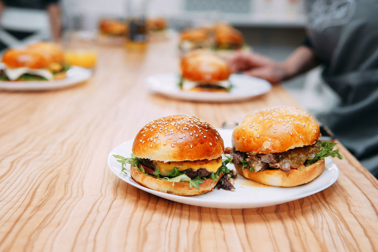 Burgers with beef and vegetables. close up. delicious burgers in a cooking class.