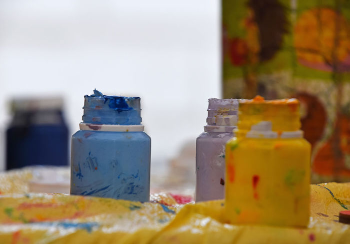 Bottles of paint at desctop of art studio Art Art And Craft Bottles Bright Close-up Colorful Colors Creative Creativity Desktop Drawing Ideas Multicolor Paint Painted Painter Painting Selective Focus Studio Surface Vibrant Vivid Your Design Story