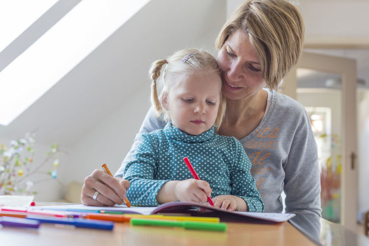 Portait of mother and daughter drawing with pencils At Home Blonde Childhood Creative Creativity Draw Drawing Education Girl Indoors  Kindergarten Learning Learning Love Motherhood Paint Painting Pen Pencils Sitting Smiling Spending Time Togetherness Unfiltered Women