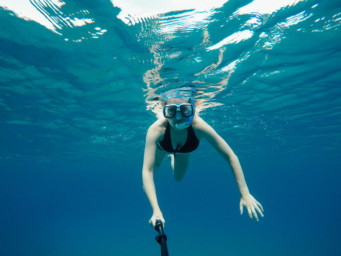 Woman Swimming Undersea
