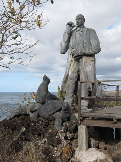 Charles Darwin, galápagos father Statue Sculpture Sky Male Likeness Human Representation Art And Craft Cloud - Sky Outdoors Day Nature Full Length Sea Tree Water Sculptor Beauty In Nature Horizon Over Water One Person An Eye For Travel An Eye For Travel
