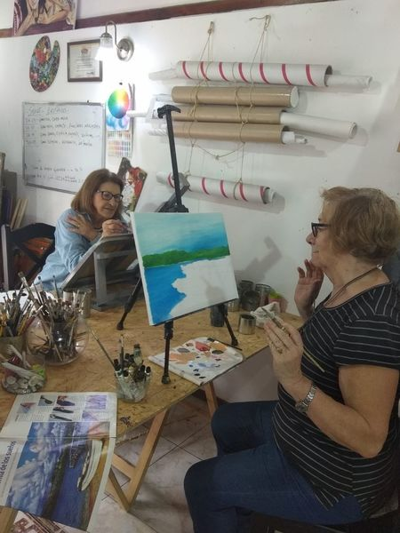 Mom paint class Creativity Indoors  Young Adult Real People Casual Clothing Art And Craft Young Women People Adult Women Table Sitting Men Young Men Business Mid Adult Design Professional Activity Leisure Activity