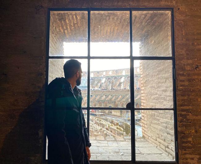 Man looking though window
