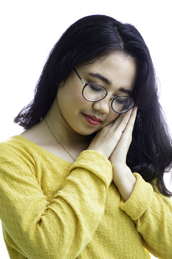 One Person Young Adult Indoors  Front View Hair Eyeglasses  Young Women Casual Clothing Black Hair Glasses Portrait Long Hair Studio Shot Hairstyle Lifestyles White Background Waist Up Leisure Activity Headshot Beautiful Woman Contemplation Teenager Scarf