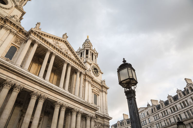 St. Paul's Cathedral in London. Low angle view. St. Paul's Cathedral Building Exterior Architecture Built Structure Sky Low Angle View Travel Destinations Cloud - Sky Street Light Building History Architectural Column Outdoors Tourism Travel Day Overcast Famous Building No People Cloudy Roman Catholic Church