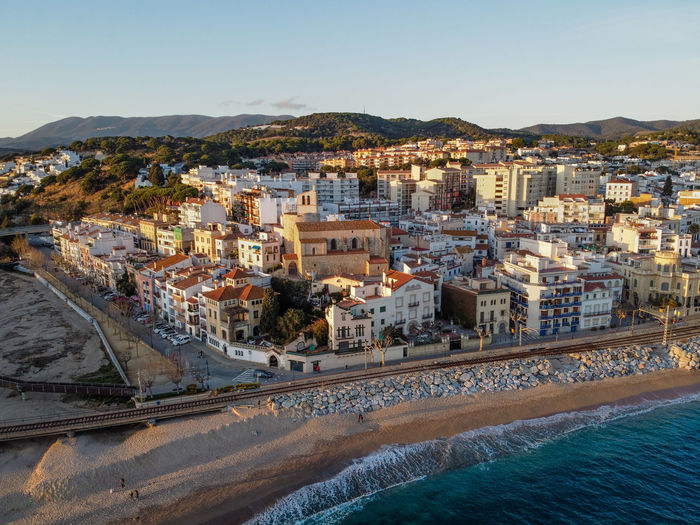 Aerial view of sant pol de mar village and its church ermita de sant jaume in el maresme coast.