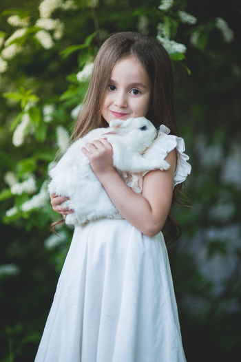 Cute little girl with white rabbit in white dress early spring may in cherry blossom White Rabbit Rabbit Rabbit - Animal Little Girl Girl Princess Mammal Cherry Blossom Spring Springtime Spring Flowers Pet Pet Photography  Friendship Outdoors Long Hair Girls Hairstyle Pink Jacket International Women's Day 2019 My Best Photo