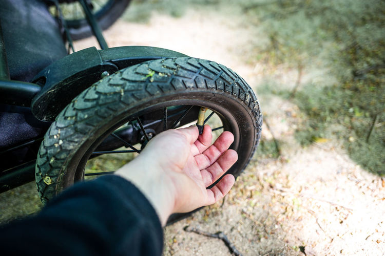 Close-up of hand holding tire