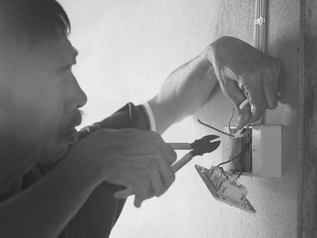 Adult Close-up Day Electric Wire Electrician  Home Interior Human Hand Indoors  Lifestyles One Person People Real People Working