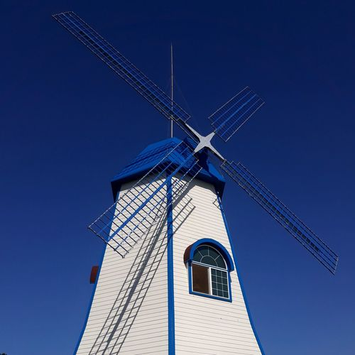blue Wind Power Alternative Energy Wind Turbine Low Angle View Windmill Traditional Windmill No People Architecture Blue EyeEmNewHere