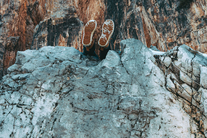 Low angle view of human legs on the rocks