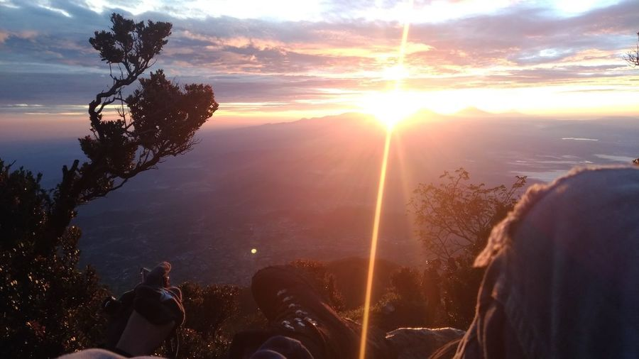 sunrise at mount slamet indonesia Mountain View Mountslamet Adventure INDONESIA Beuty Of Nature Go Higher Tree Sunset Mountain Human Hand Sun Sky Landscape Cloud - Sky Travel