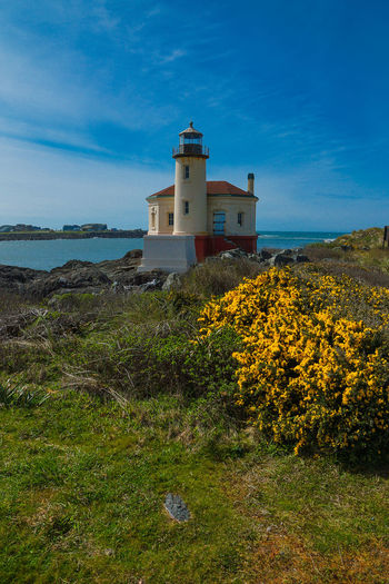 Architecture Bandon, Oregon Beach Beauty In Nature Blue Building Exterior Built Structure Coquille River Lighthouse Coquille River (Bandon) Lighthouse Day Grass House Landscape Lighthouse Nature No People Outdoors Scenics Sea Sky Tranquil Scene Tranquility