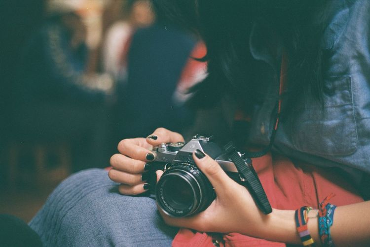 Arts Culture And Entertainment Camera - Photographic Equipment Casual Clothing Colors Film Focus On Foreground Holding Human Body Part Leisure Activity Lifestyles Men Mobile Phone Music Part Of Person Photographing Photography Photography Themes Real People Smart Phone Technology