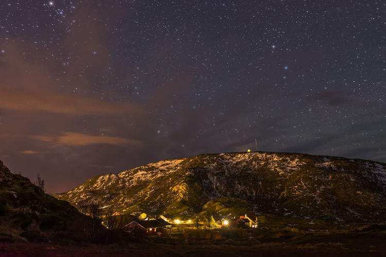 Hillesoy at night, Norway Astrophotography Clouds Dark House Lights Mountain Nature Night Night Photography Norway Sky Snow Stars The Great Outdoors - 2016 EyeEm Awards Town Village Long Exposure Landscapes Feel The Journey Original Experiences Showcase June 43 Golden Moments Overnight Success