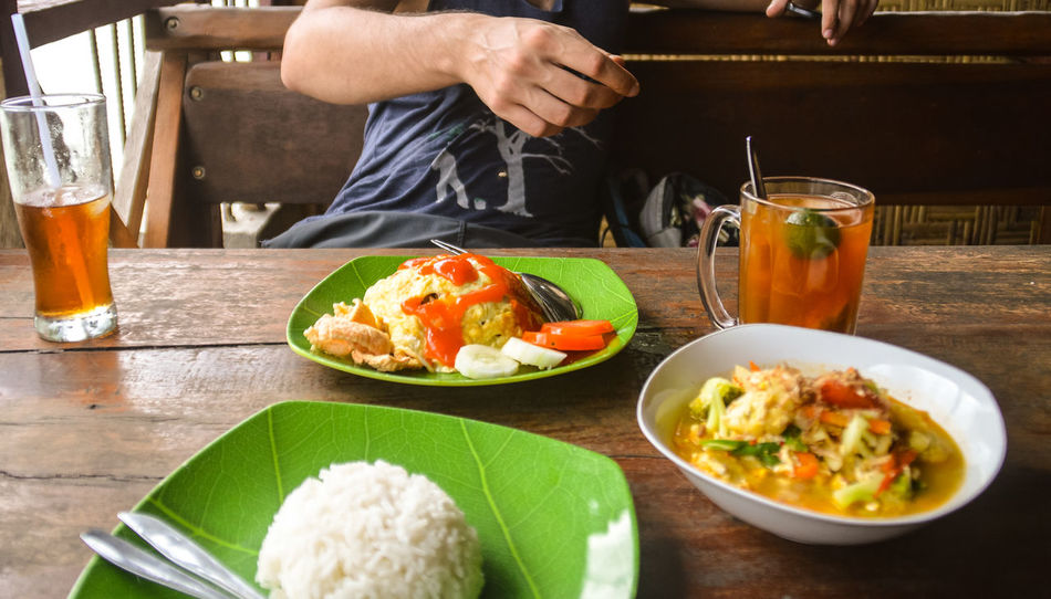 Summer Holiday Vacation Indonesian Food Indonesian Breakfast Indonesian Cuisine Food And Drink Midsection Food Healthy Eating One Person Plate Table One Man Only Freshness Drink Vegetable Healthy Lifestyle Human Body Part Only Men Food Stories