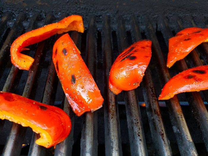 High angle view of orange on barbecue grill
