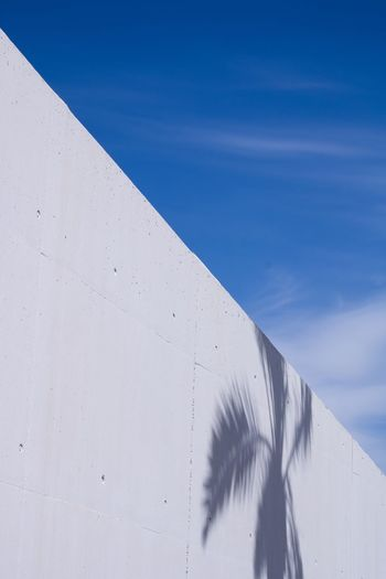 Low angle view of white wall against sky