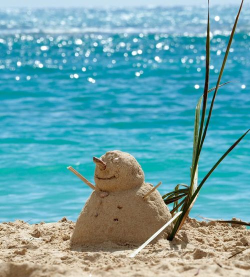 Snowman Made Of Sand At Beach