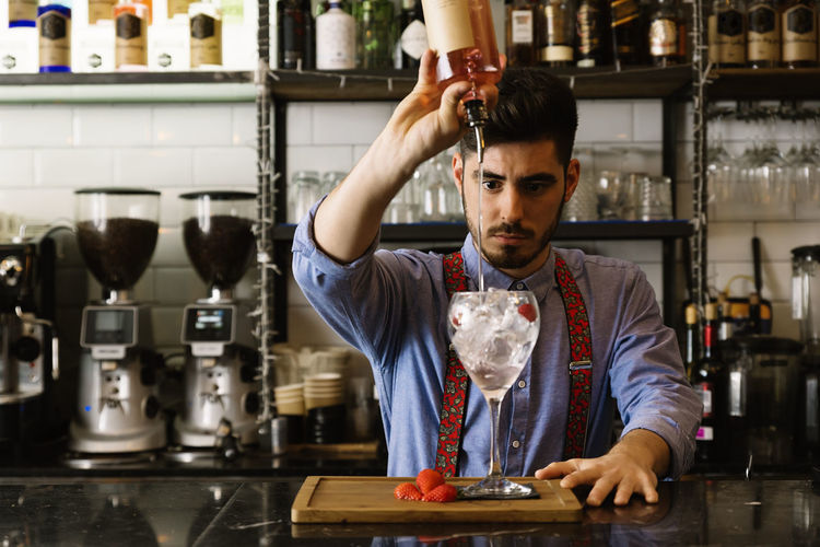 Bartender Preparing Drink In Bar