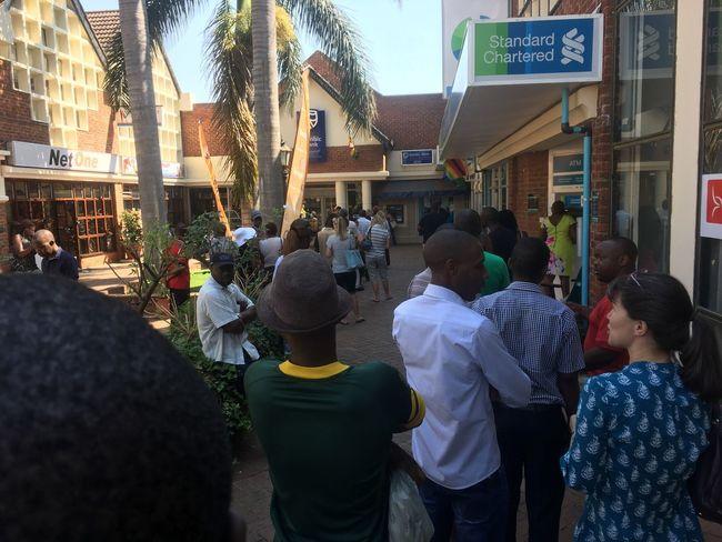 CashCrisis Zimbabwe BondNotes Zimbabweseries Zimbabwe City Crowd Architecture Built Structure Day Queues Crisis StandardChartered The Photojournalist - 2017 EyeEm Awards