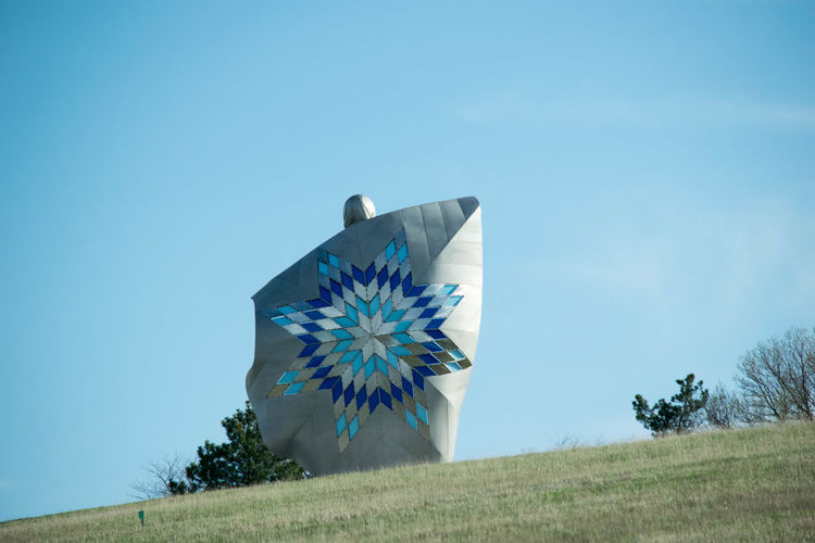 Dignity Native American Indian South Dakota Statue Architecture Beauty In Nature Blue Built Structure Chamberlain Clear Sky Copy Space Day Environment Environmental Conservation Field Grass Land Landscape Low Angle View Native American Nature No People Outdoors Plant Sky Sunlight