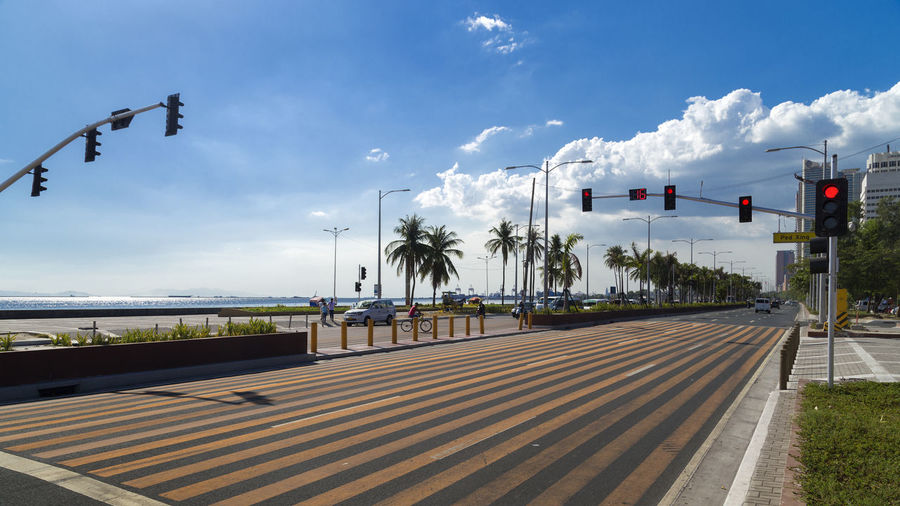 No traffic on Roxas boulevard on a Saturday in Manila Cloud - Sky Sky Transportation Nature Road Plant Sign Street Tree Day Symbol No People Crosswalk Street Light Road Marking City Zebra Crossing Outdoors Marking Architecture Guidance Light Manila Bay  Roxas Boulevard Manila Road No Traffic Holiday EyeEm Best Shots EyeEmNewHere EyeEm City Shots EyeEm Selects Philippines Relexing Panorama Wide Angle