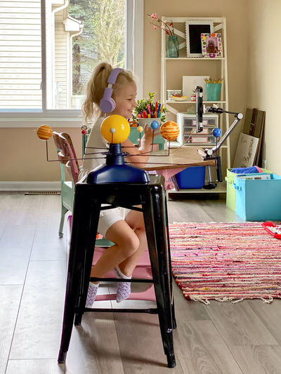 Women sitting on table at home