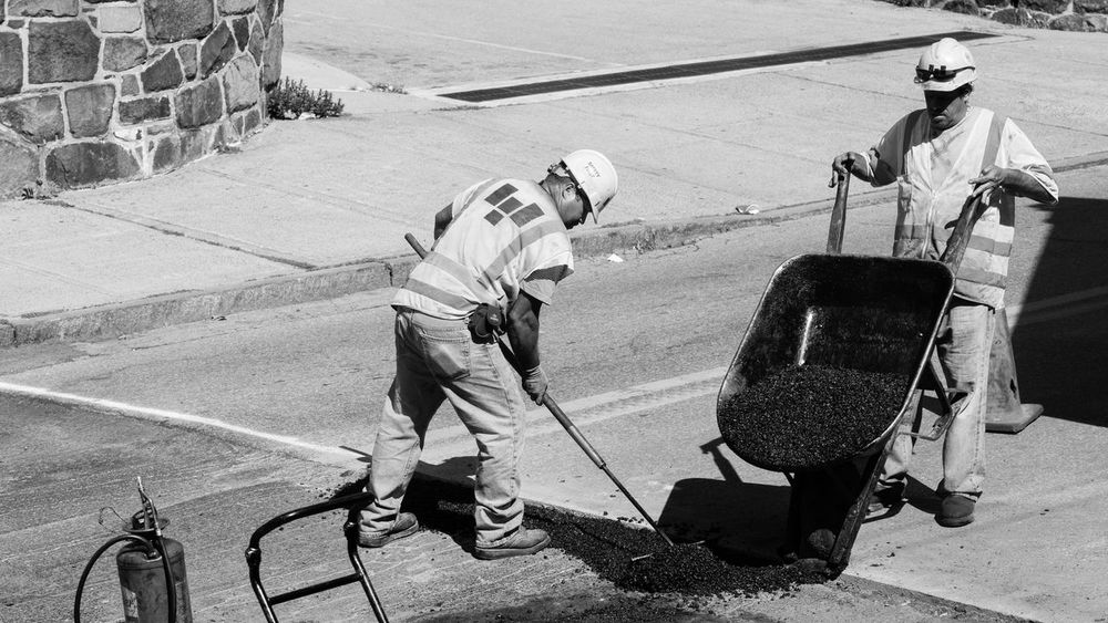Tag team. Black And White Photography Candid Photography Streetphoto_bw Teamwork Asphalt Patch Hard Hats Vests Sony A6000 Project365