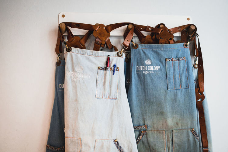 Aprons hanging on wall