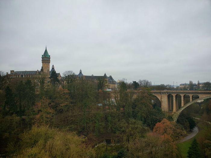 Arch bridge over buildings in city
