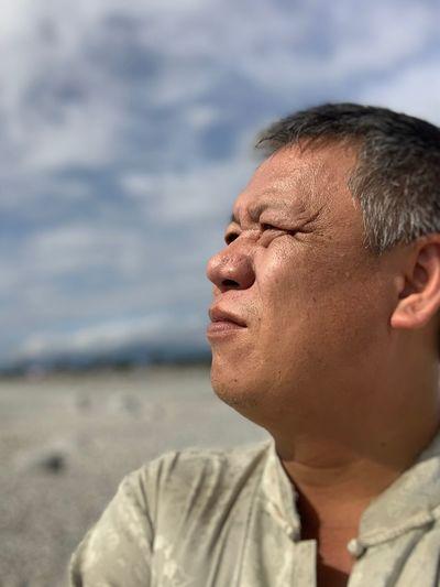 Close-up of mature man looking away