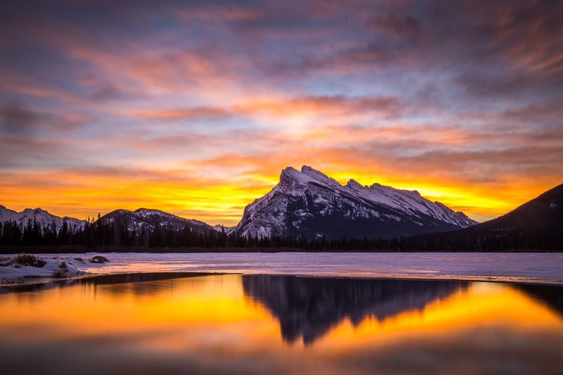Fire in the Sky at Vermillion Lakes, Banff, Canada Beauty In Nature Sunrise Scenics Nature Tranquil Scene Mountain Tranquility Sky Lake Reflection Water Cloud - Sky Idyllic No People Mountain Range Outdoors EyeEmNewHere The Week On EyeEm Banff National Park  Banff  Canada Alberta Rocky Mountains EyeEmNewHere The Week On EyeEm