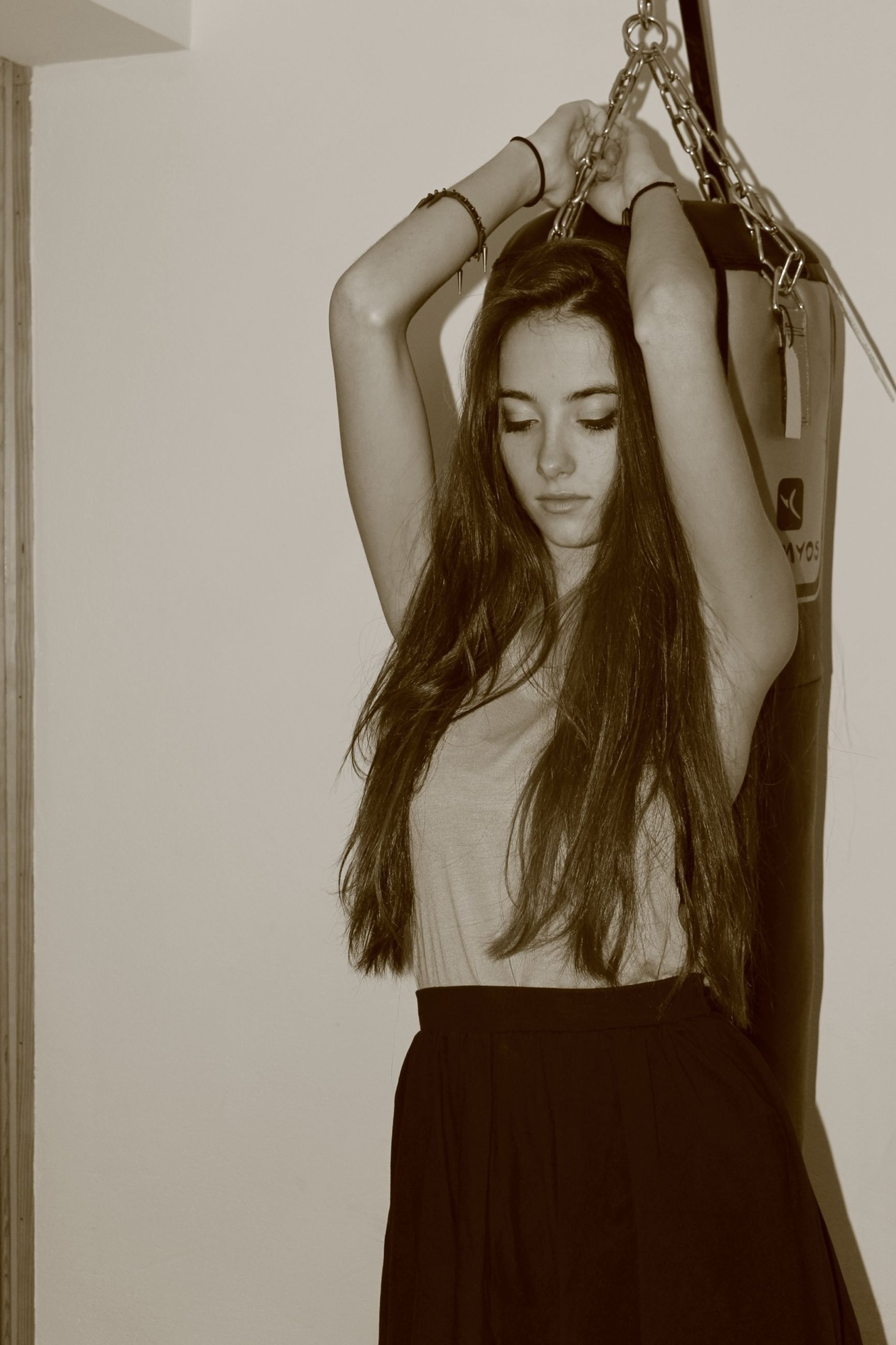 young adult, young women, long hair, indoors, lifestyles, sensuality, front view, three quarter length, femininity, art, standing, person, fashion, leisure activity, human representation, creativity, art and craft