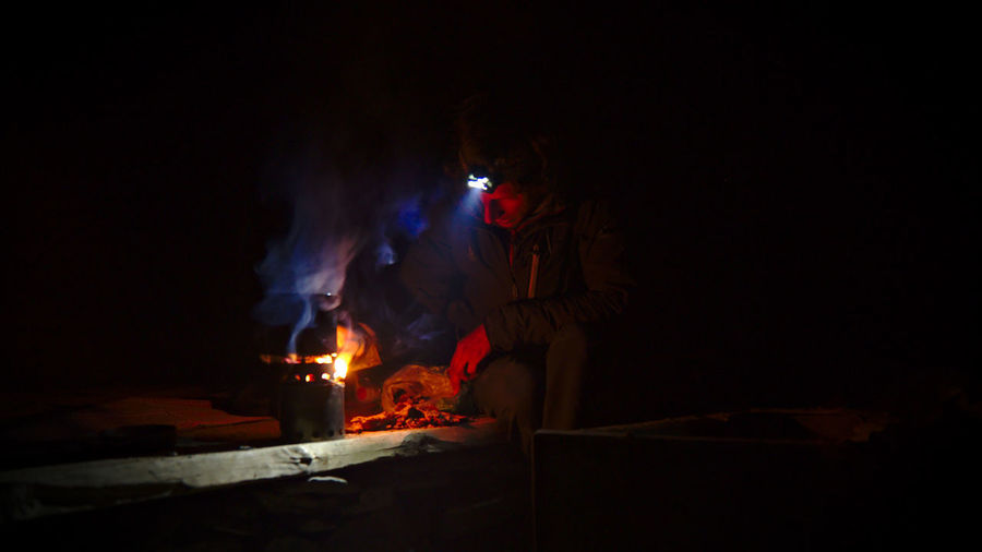 People on fire at night