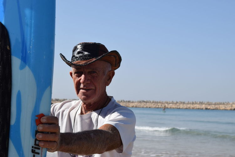 Adult Adults Only Beach Blue Close-up Day Exercising Healthy Lifestyle Lifestyles Men One Man Only One Person One Senior Man Only Only Men Outdoors People Portrait Retirement Sea Senior Adult Senior Men Sky Sports Clothing Water Wellbeing