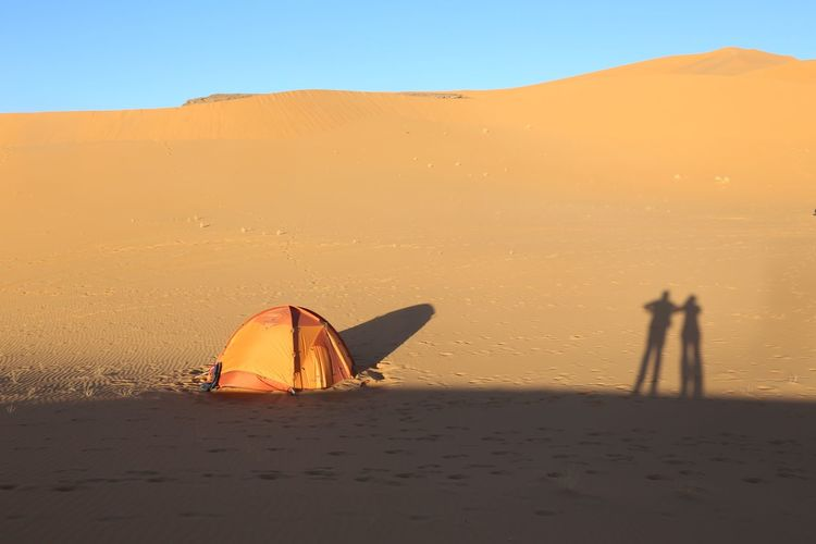 Shadow of people at desert