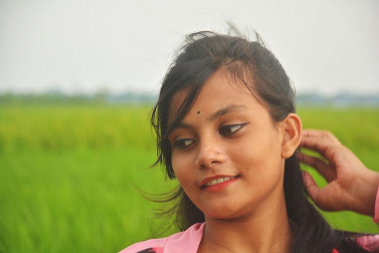 Portrait of smiling woman on field