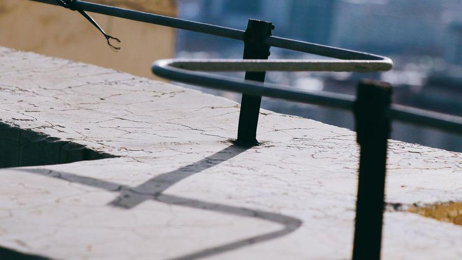 Close-up of railing on footpath