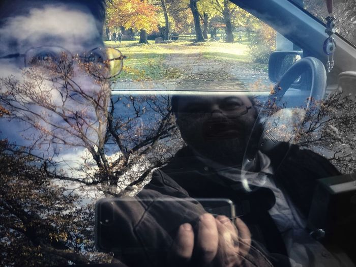 1POI Dual Environmental Portrait Tree Real People Day One Person Car Leisure Activity Outdoors Nature Forest Sitting Branch Close-up Reflections Car Interior Landscape People A New Beginning