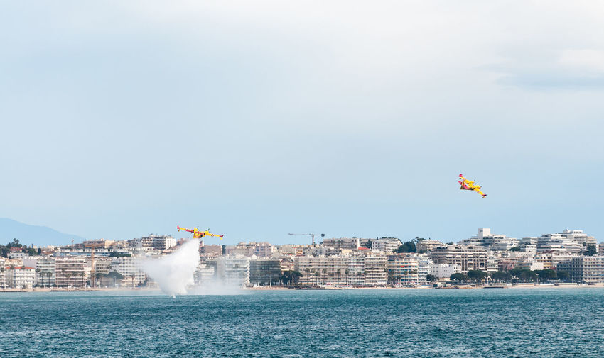 Air Vehicles Flying Over Sea Against Sky
